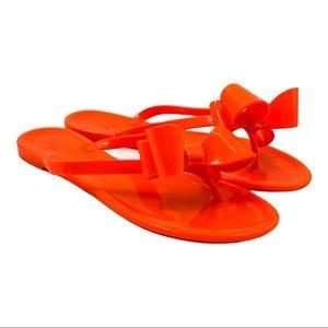 Kalli Neon Orange Bow Jelly Flip Flop Sandals